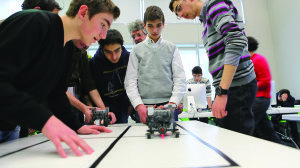 Students experiment in robotics during a workshop at Tumo.