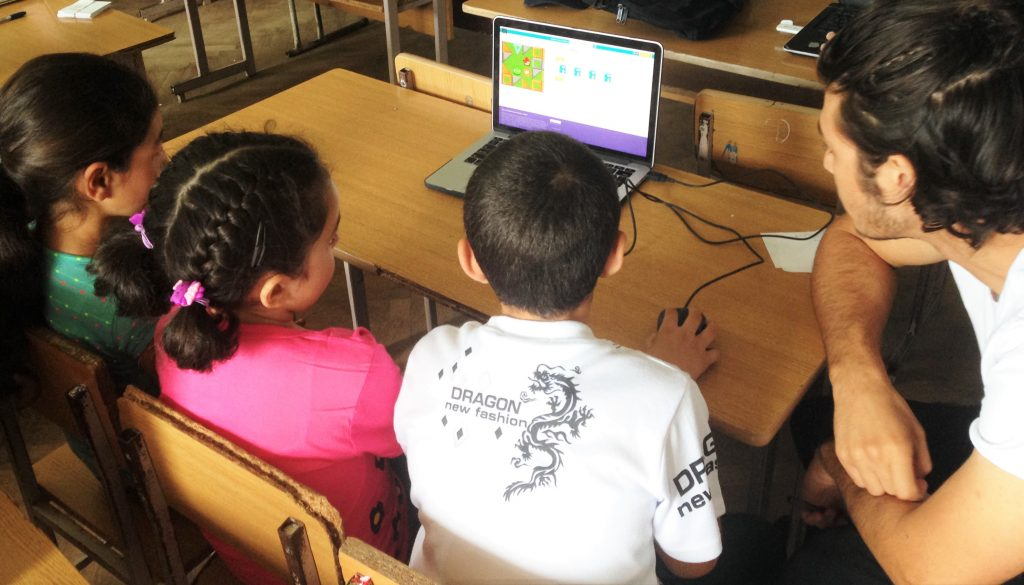 The Luys Scholar is helping the children to create their first animation project.